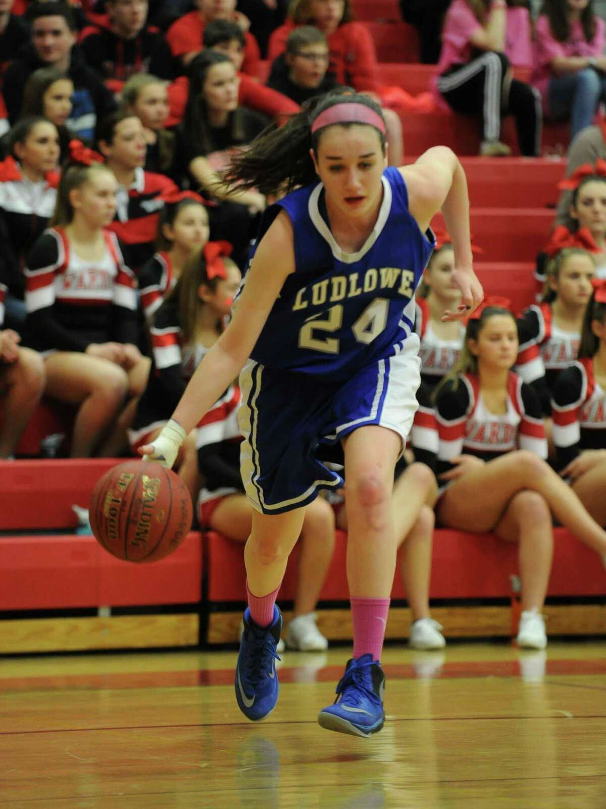 Alex McKinnon (24) of Fairfield Ludlowe bring the ball up the floor during a game against Fairfield Warde at Fairfield Warde High School on February 11, 2016 in Fairfield, Connecticut.
