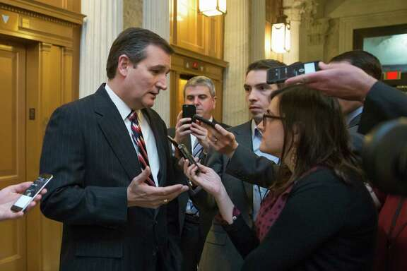 FILE - In this Feb. 10, 2016 file photo, Republican presidential candidate, Sen. Ted Cruz, R-Texas talks to reporters outside the Senate chamber on Capitol Hill in Washington. Cruz has campaigned against government spying on law-abiding citizens, but his campaign is testing the limits with personal data from his supporters. (AP Photo/J. Scott Applewhite)