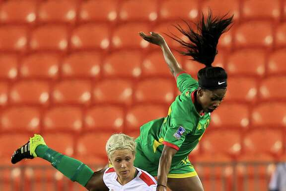Guyana's Otesha Charles, top, shows her aggressive play as she vies for possession with Canada's Sophie Schmidt on Thursday at BBVA Compass Stadium.