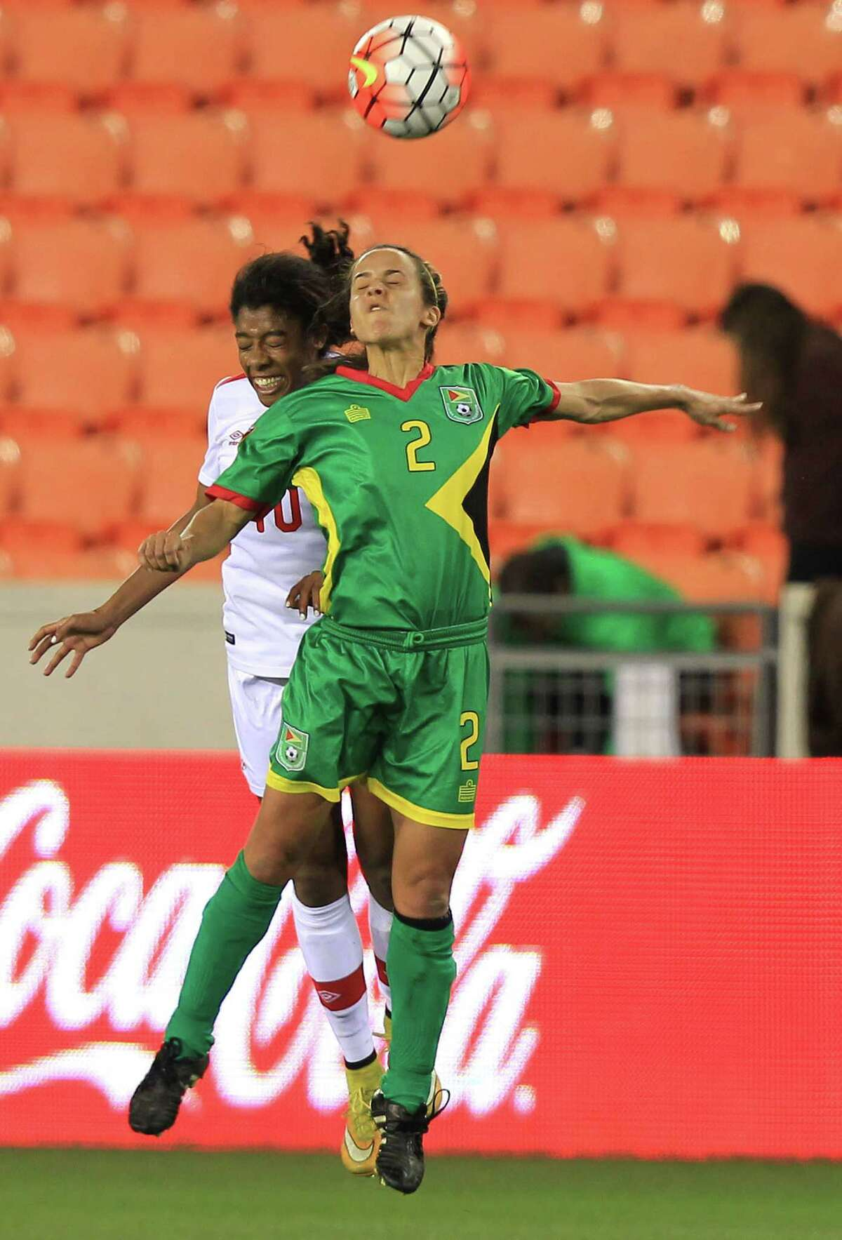 Guyana's Alison Heydorn (2) goes up for a header with Canada's Ashley Lawrence (10) in the first half of of CONCACAF Women's Olympic Qualifiers at BBVA Compass Stadium on Thursday, Feb. 11, 2016, in Houston.