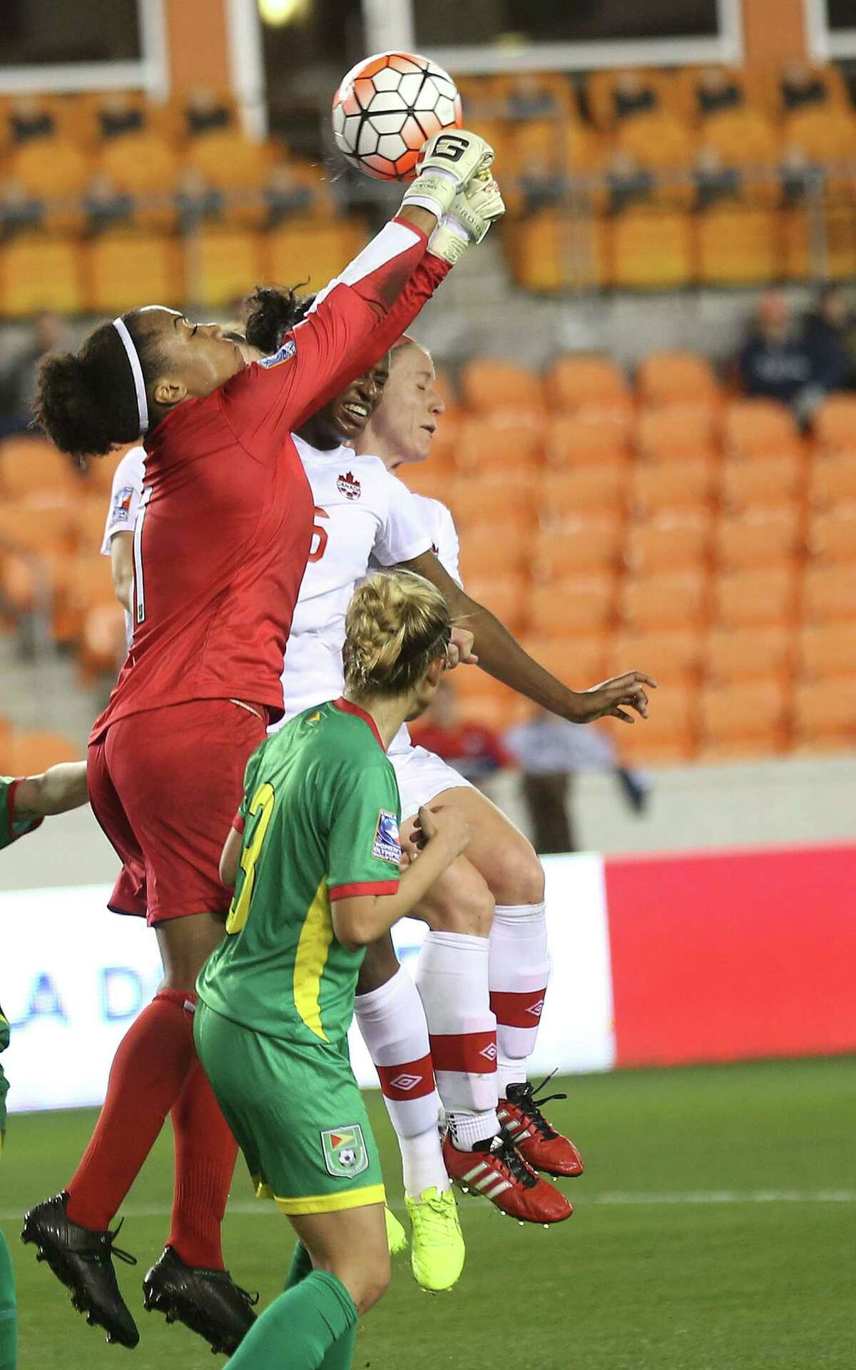 Guyana's goalie Chante Sanford (1) hits the ball out of play in the second half of CONCACAF Women's Olympic Qualifiers against Guyana at BBVA Compass Stadium on Thursday, Feb. 11, 2016, in Houston. Canada won the game 5-0.