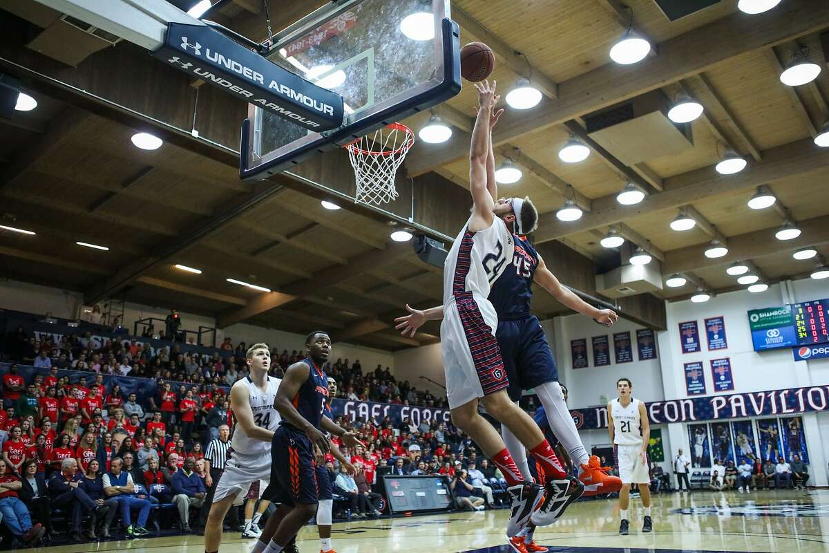 St.Mary's forward Calvin Hermann (24) soars as he attempts to score against Pepperdine at McKeon Pavilion at St.Mary's in Moraga, California on Thursday, February 11, 2016.