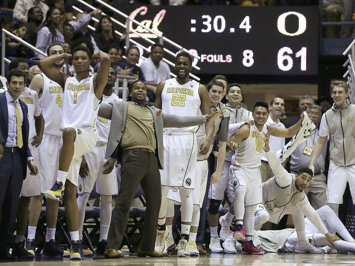 California basketball players including Ivan Rabb (1) and Kingsley Okoroh (22) celebrate in the final minute of play during an NCAA college basketball game against Oregon Thursday, Feb. 11, 2016, in Berkeley, Calif. (AP Photo/Ben Margot)