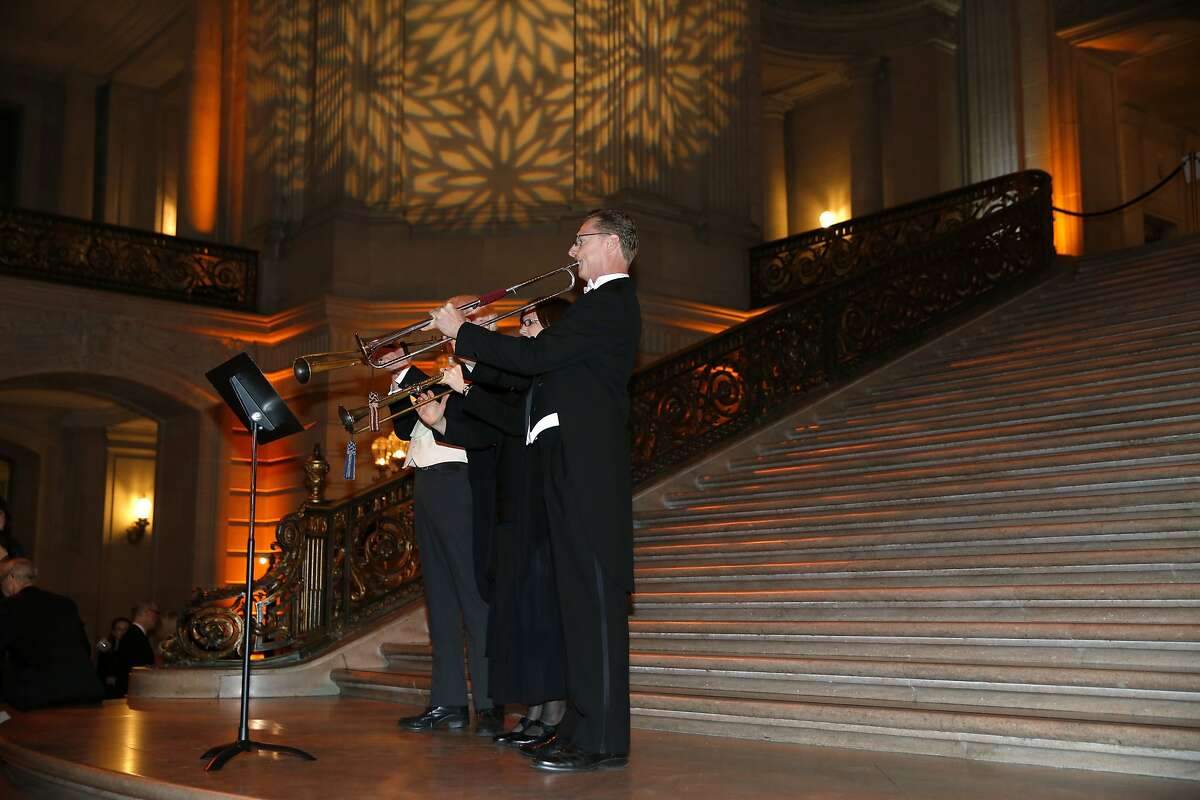 Trumpeters announce the beginning of dinner during a gala celebrating the 30th anniversary of the Philharmonia Baroque Orchestra's music director Nicholas McGegan at San Francisco City Hall on Thursday, Feb. 11, 2016.