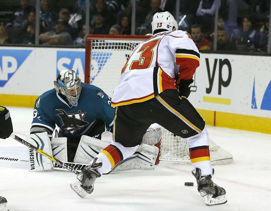 Sharks goalie Alex Stalock blocks a shot by Calgary's Johnny Gaudreau, who had two assists, during the second period. Photo: Tony Avelar, Associated Press
