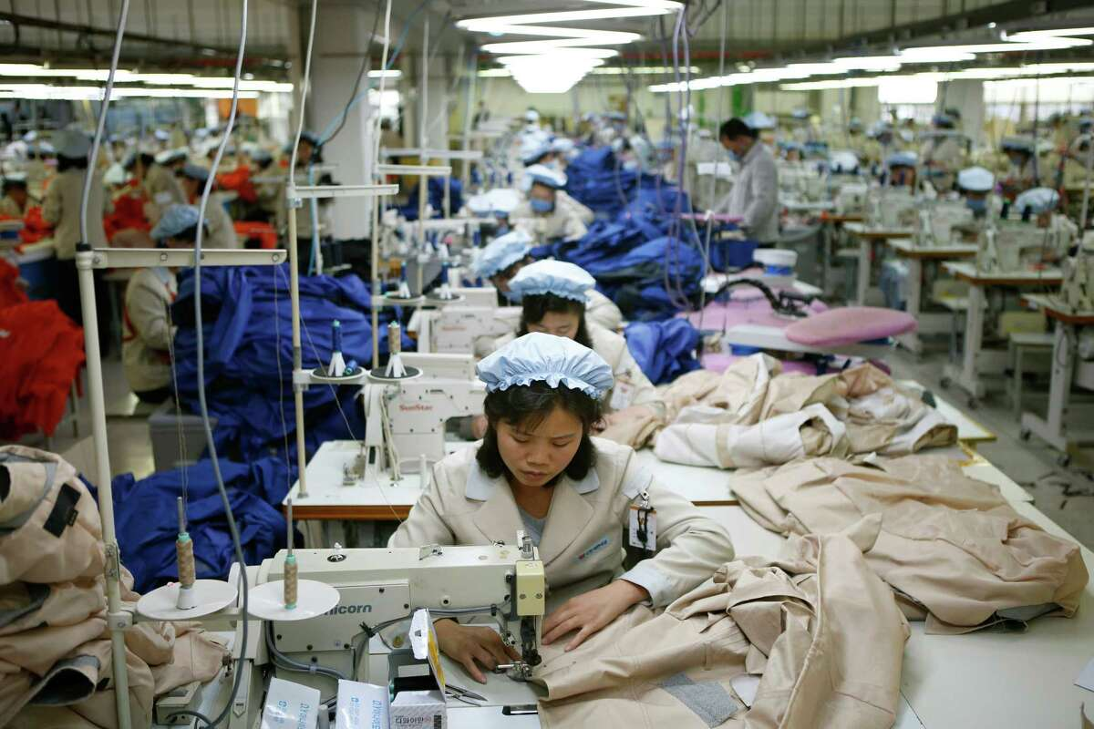 File photo of a North Korean clothing factory on Dec. 19, 2013. Rip Curl, a popular surf wear company, admitted that their winter 2015 Mountain-wear collection was made in Taedonggang Clothing Factory in North Korea, known for its poor working conditions.