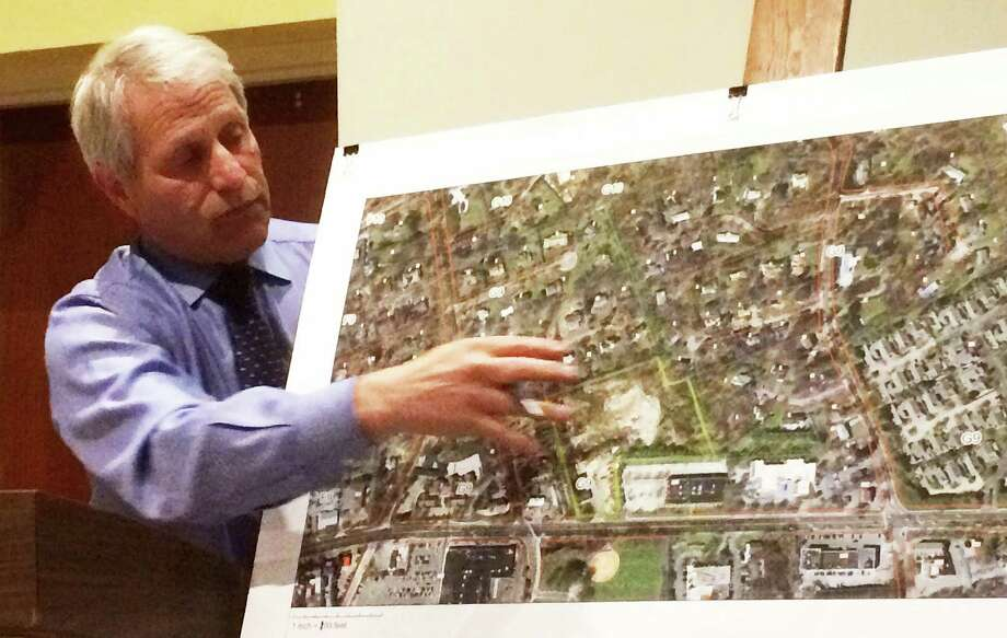Land-use consultant Richard Redniss explains to the Planning and Zoning Commission proposed text amendment changes that he said are needed to allow plans to build affordable housing on two Post Road East properties move forward. Photo: Westport News / Chris Marquette / Westport News