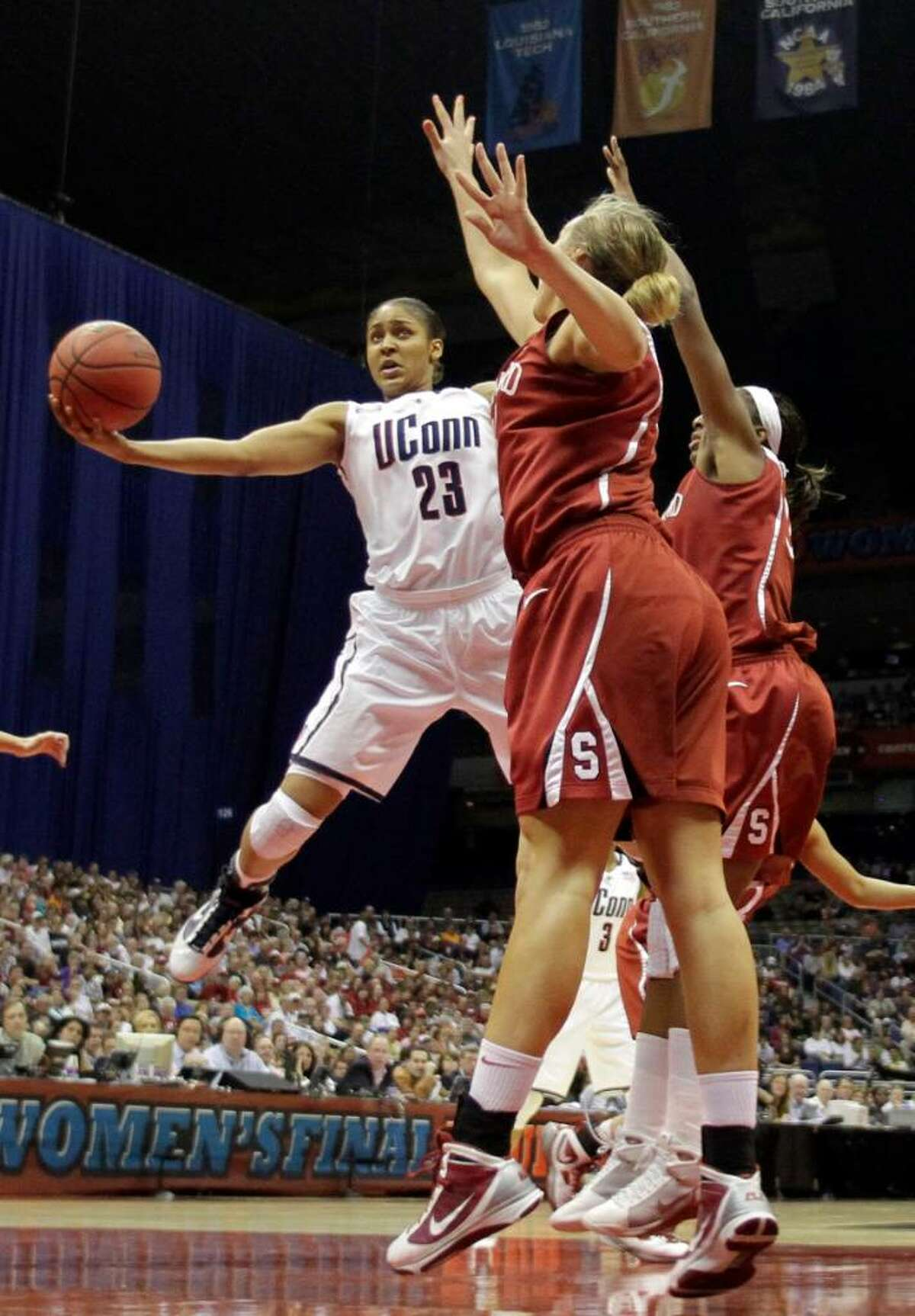 Connecticut's Maya Moore (23) attempts a shot over Stanford's Jayne Appel, front, in the first half of the women's NCAA Final Four college basketball championship game Tuesday, April 6, 2010, in San Antonio. (AP Photo/Eric Gay)