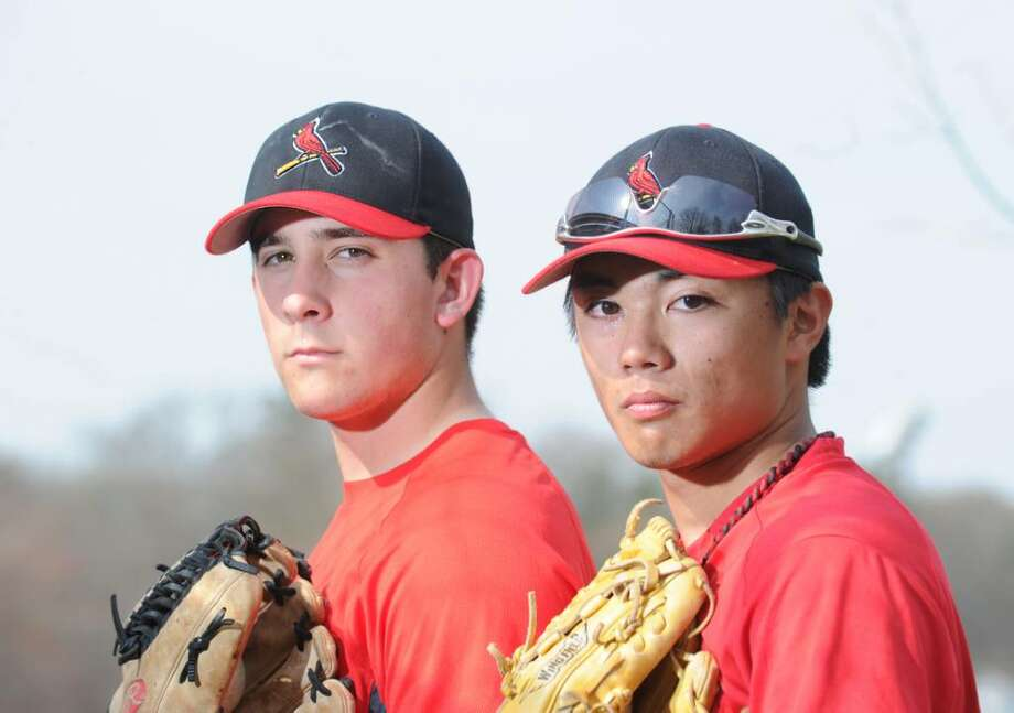 Greenwich High School baseball captains, Kevin Collins, left and Yuta Okazaki, posed on the Greenwich High School baseball field, Tuesday, April 6, 2010. Photo: Bob Luckey / Greenwich Time