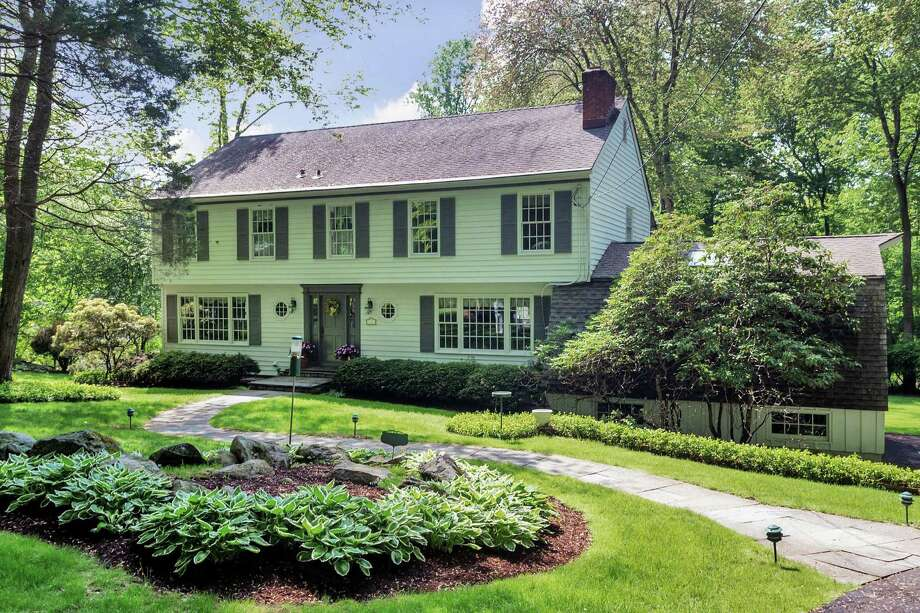 The property at 16 Salem Lane is on the market for $1,415,000. The 4,081-square-foot Colonial was built in 1975. Photo: Contributed Photo / Contributed Photo / Westport News