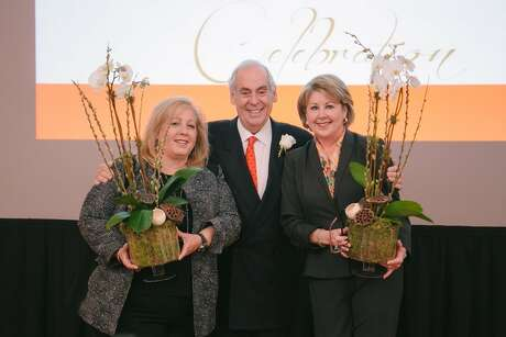 John A. Daugherty Jr. is shown with his executive team Anne Incorvia, left, and Cheri Fama at the Feb. 2 event.