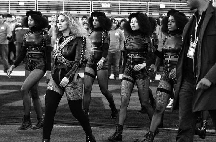 Beyonce and dancers enter the Super Bowl field in formation.