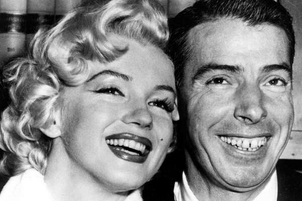 "FILE - In this Jan. 14, 1954 file photo, New York Yankees' Joe Dimaggio, right, poses with actress Marilyn Monroe, as they wait for their marriage ceremony in San Francisco. ""Insignificance"" a play that depicts what it might have been like had Marilyn Monroe, Joe DiMaggio, Albert Einstein and Senator Joe McCarthy met in a hotel room in 1953 will make its New York debut next month in a hotel room. (AP Photo, File)"