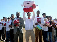 Hundreds of West Brook High School sophomore boys bearing candy and gifts gather in a heart shape to ask classmate Marin Andress to be their Valentine. Marin is currently in Houston at Texas Children's Hospital receiving another round of chemotherapy. Assistant Principal Shy Randle-Filer organized the event, providing red ties for those boys who didn't have one, to show Marin that they are behind her in her battle with cancer. The boys and other school members brought toys, candy, jewelry, flowers and money, which will be given to Marin. An overhead drone videotaped the event outside the school Thursday, which will also be given to Marin and her family.  Photo taken Thursday, February 11, 2016  Kim Brent/The Enterprise