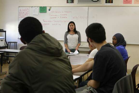 Michelle Wong directs the students during an SAT Prep class held at Berkeley High School in Berkeley, Calif., Thursday, Feb. 11, 2016