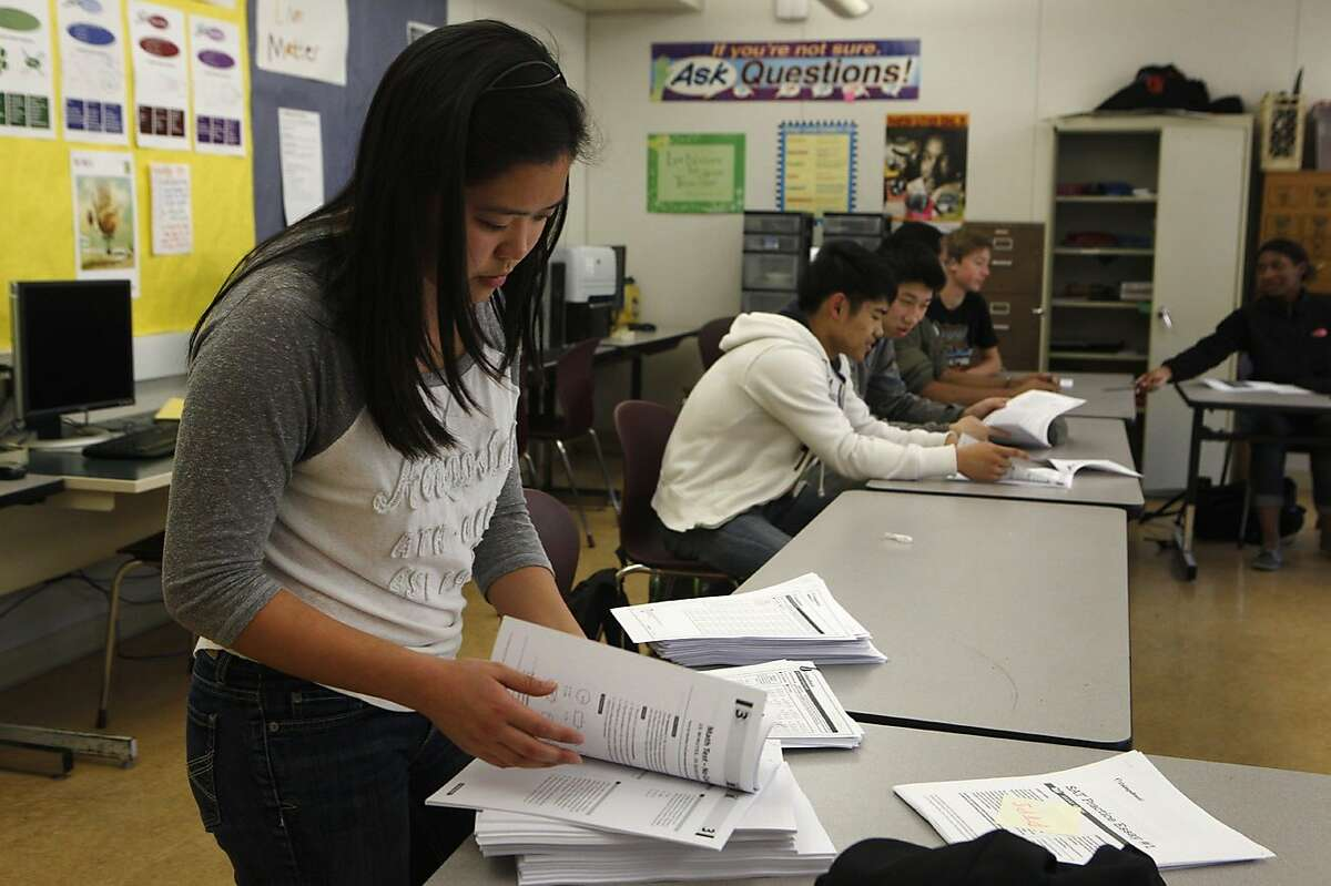 Michelle Wong prepares the practice tests for the students during an SAT Prep class held at Berkeley High School in Berkeley, Calif., Thursday, Feb. 11, 2016