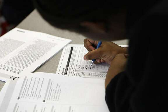 Rajah Allah fills out her practice test during an SAT Prep class held at Berkeley High School in Berkeley, Calif., Thursday, Feb. 11, 2016