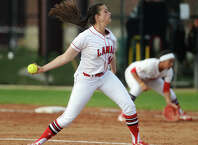 Lamar's Laura Napoli, No. 30, pitches against a Nicholls hitter during Friday's game. The Lamar Lady Cardinals hosted the Nicholls Colonels at the Lamar Softball Complex on Friday afternoon. Photo taken Friday 5/1/15 Jake Daniels/The Enterprise who went 19-17 with two saves and a 3.89 ERA to lead the pitching staff,  is joined by senior right-hander Lauren Dannelley (7-9,  4.67) along with junior transfer Ciara Luna at the top of the rotation.