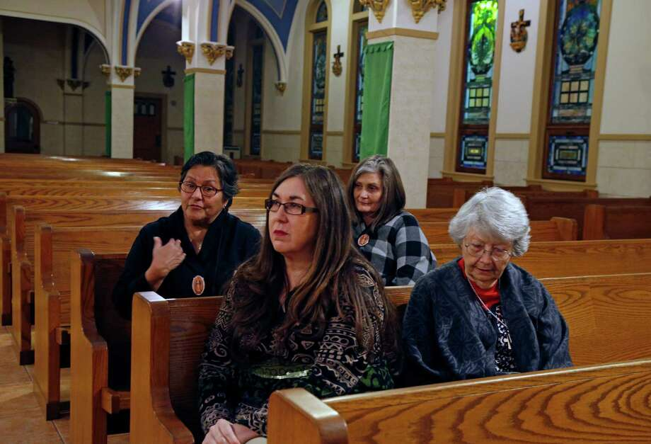 Andrea Chapa,Sandy McIver(mom to Shannon Hasse) in front and Mirta Rubalcava , Shannon Haase are all going to see the Pope talk to the reporter in the church. Though tough to score tickets to the pope's Mass in Juarez, a few San Antonians have managed, and they include various members of Our Lady of Guadalupe Church on the city's West Side. They'll travel with their priest, Father Michael Bouzigard, who'll assist during the Mass. (Sandy McIver is going to see the Pope but not traveling with this group. Photos taken on Monday, February 8 2016 Photo: Photos By Ronald Cortes / For The San Antonio Express-News