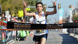 David Fuentes, a former standout in cross country at Boerne High School, crosses the finish line in first place during the 2011 San Antonio Rock 'n' Roll Marathon on Nov. 13.