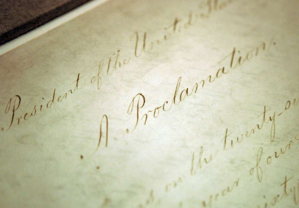 This Feb. 18, 2005 file photo shows the original Emancipation Proclamation on display in the Rotunda of the National Archives in Washington. As New Year's Day approached 150 years ago, all eyes were on President Abraham Lincoln in expectation of what he warned 100 days earlier would be coming _ his final proclamation declaring all slaves in states rebelling against the Union to be