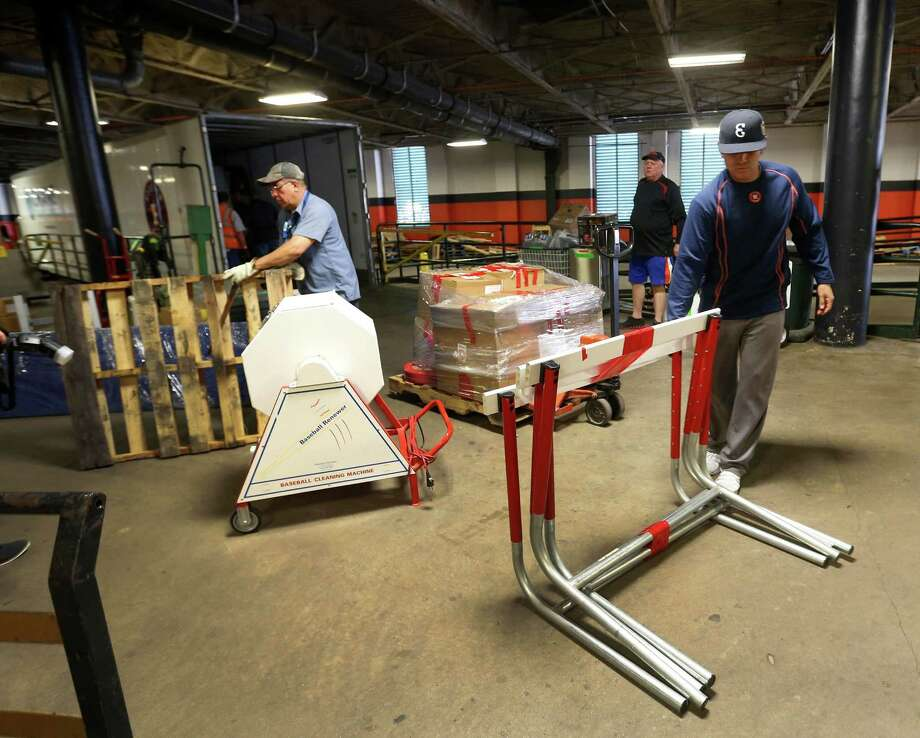 Astros bullpen catcher, Carlos Munoz, moves hurdles to be loaded, as the Astros equipment truck was being loaded, as they prepared to head to spring training, Friday, Feb. 12, 2016. Photo: Karen Warren, Houston Chronicle / © 2015  Houston Chronicle