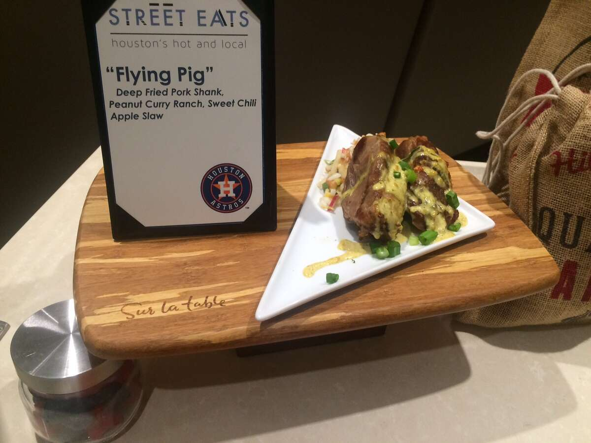 """New Food:""""The Flying Pig"""" A deep fried pork shank in peanut curry ranch, served with a sweet chili apple slaw."""