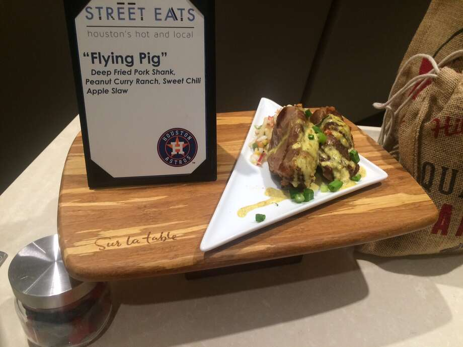 """New Food:""""The Flying Pig""""A deep fried pork shank in peanut curry ranch, served with a sweet chili apple slaw. Photo: John Boyd"""
