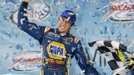Chase Elliott celebrates winning the NASCAR Xfinity Series auto race at Richmond International Raceway on Sept. 11, 2015. With four-time champion Jeff Gordon retired and three-time champ Tony Stewart sidelined with a broken back, the NASCAR season begins with a much different look and a new rules package.