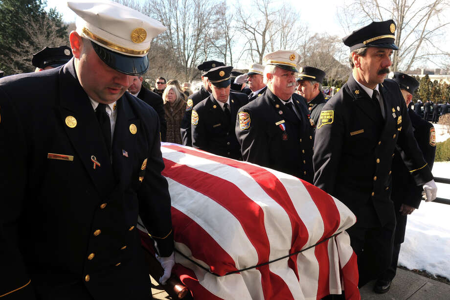 Funeral services for former Derby Fire Chief James J. Butler, held at Holy Rosary Church in Ansonia, Conn. Feb. 12, 2016. Butler, 50, a 35-year veteran of the Derby Fire Department, died Sunday shortly after responding to a fire call. Photo: Ned Gerard / Hearst Connecticut Media / Connecticut Post
