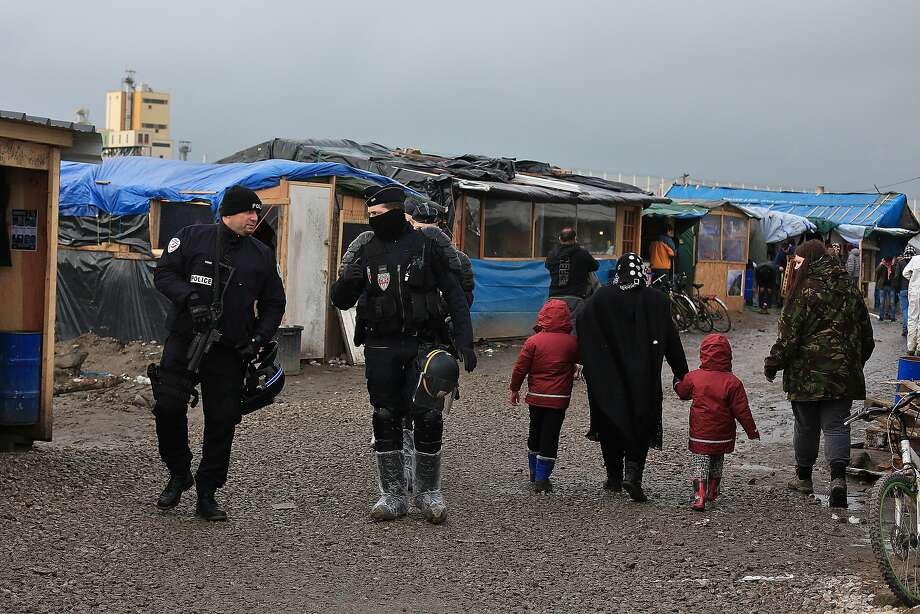 French police patrol the refugee camp in Calais. The city is becoming a tinderbox fueled with anti-refugee rage and a breeding ground for sympathizers of far-right movements. Photo: Thibault Camus, Associated Press
