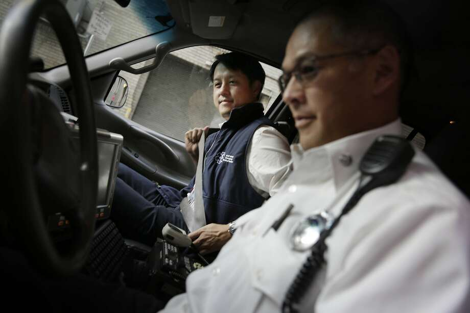 Dr. Clement Yeh (l to r) buckles his seat belt as he heads out with Captain Simon Pang as they head out into the field with the EMS-6 team on Thursday, February 11, 2016 in San Francisco, Calif. Photo: Lea Suzuki, The Chronicle