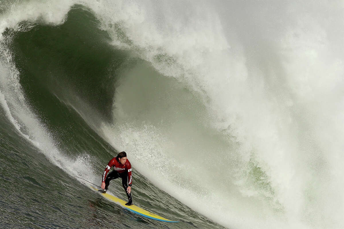 Colin Dwyer rides a wave during the second heat of round one of Mavericks Invitational on January 24, 2014 in Half Moon Bay, California. (Photo by Ezra Shaw/Getty Images)