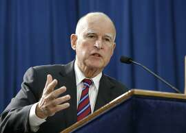 FILE -- In this Jan. 7, 2016 file photo, Gov. Jerry Brown answers a question concerning his proposed 2016-17 state budget at a news conference, in Sacramento, Calif. In an attempt to reduce the state's prison population, Brown announced Wednesday, Jan. 27, 2016, a ballot initiative that if approved by voters in November, would increase sentencing credits for inmates who complete rehabilitation programs.  It would also allow non-violent felons to seek parole after they have competed their base sentences and require judges instead of prosecutors to decide if juveniles should be tried in adult court.(AP Photo/Rich Pedroncelli, File)