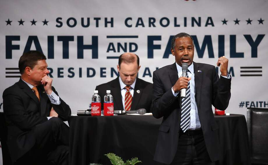 GOP candidate Dr. Ben Carson (right) speaks at the Faith and Family forum at Bob Jones University in Greenville, S.C., along with South Carolina Attorney General Alan Wilson (left). Photo: Paul Sancya, Associated Press