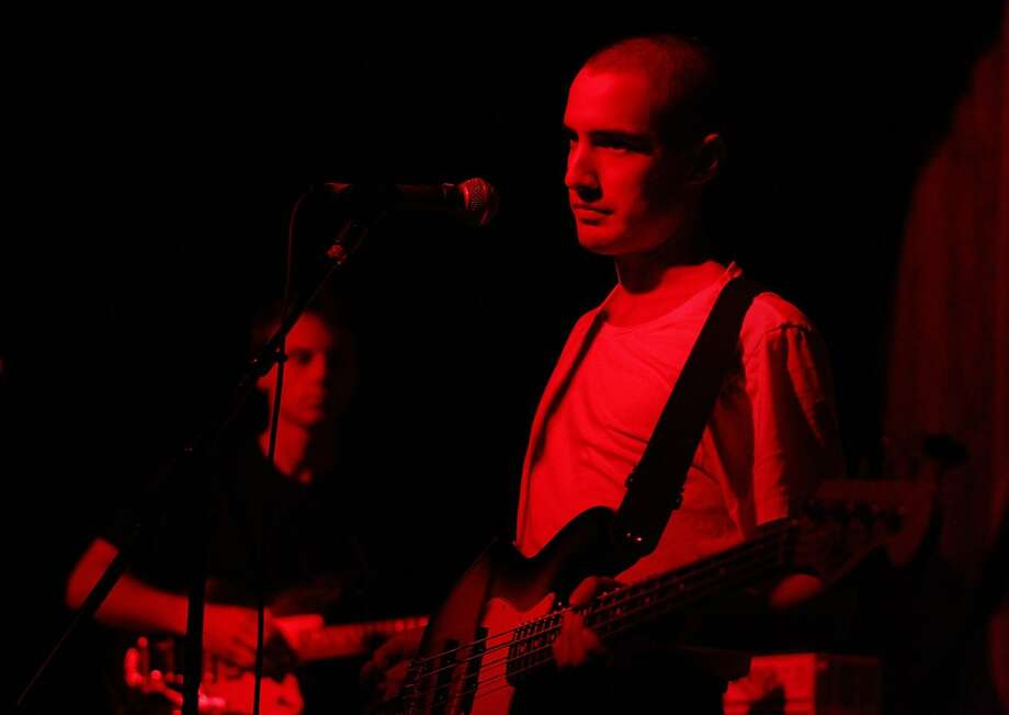 Christopher Adams (left) and Niko Escudero, members of the Bay Area band Never Young, prepare to perform at the Brick and Mortar Music Hall in San Francisco. Photo: Brittany Murphy, The Chronicle