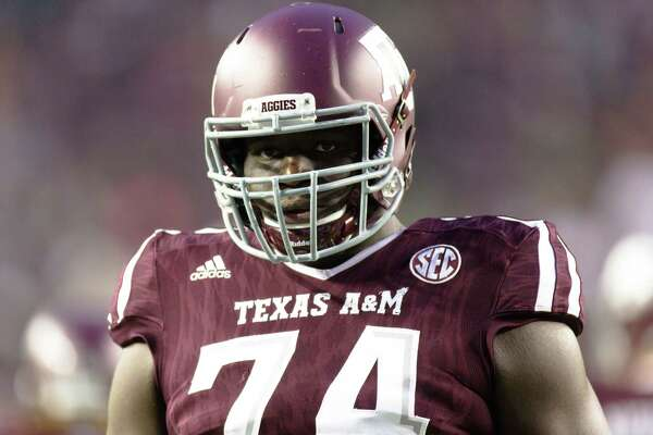 Texas A&M's offensive lineman Germain Ifedi (74) on the field warms up before an NCAA college football game against Western Carolina, Saturday, Nov. 14, 2015, in College Station, Texas. (AP Photo/Juan DeLeon)