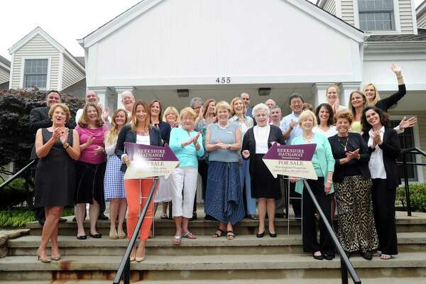 Employees of Berkshire Hathaway HomeServices New England Properties, in front of their Darien, Conn., office, Thursday, July 9, 2015. The company placed first in the Top Workplaces survey in the large company category by Hearst Media Services.