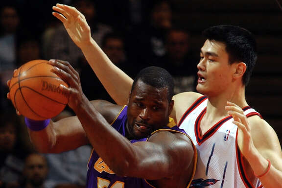 Houston Rockets Yao Ming tries to control Los Angeles Lakers Shaquille O'Neil (34) in the first half of play, March 26, 2003  at the Compaq Center in Houston.  CHRISTOBAL PEREZ/ HOUSTON CHRONICLE.  HOUCHRON CAPTION (03/27/2003-2-STAR):  Yao Ming, right, tries to control Lakers center Shaquille O'Neal in the first half Wednesday. O'Neal finished with 39 points on 16-of-26 shooting in the Lakers' 96-93 victory at Compaq Center. He also had five rebounds.  HOUCHRON CAPTION  (03/27/2003):  Yao Ming, right, tries to control Lakers center Shaquille O'Neal in the first half Wednesday. O'Neal finished with 39 points.  HOUCHRON CAPTION (12/25/2003):  Yao Ming has position but Shaquille O'Neal has the ball - and had a ball, scoring 39 points when the teams met last March 26.