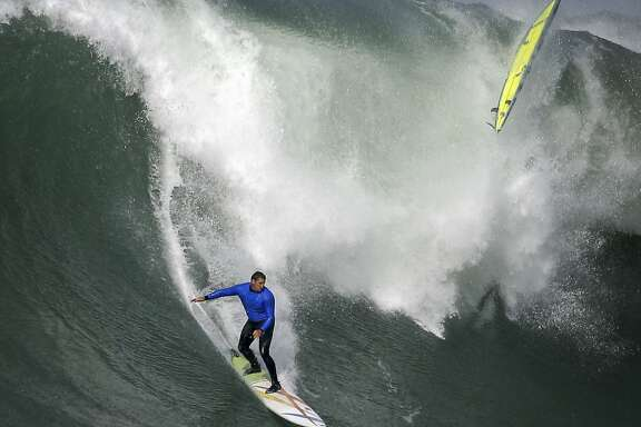 Ben Wilkinson rides a wave in heat number three in the first round of the Titans of Mavericks competition in Half Moon Bay , Calif., on Friday, February 12, 2016.