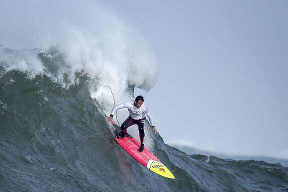 Anthony Tashnik rides a wave in heat number one in the first round of the Titans of Mavericks competition in Half Moon Bay , Calif., on Friday, February 12, 2016.