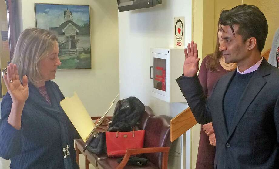 Vik Muktavaram is sworn in to fill a vacant Board of Education seat by Town Clerk Patricia Strauss. Photo: Westport News / Chris Marquette / Westport News