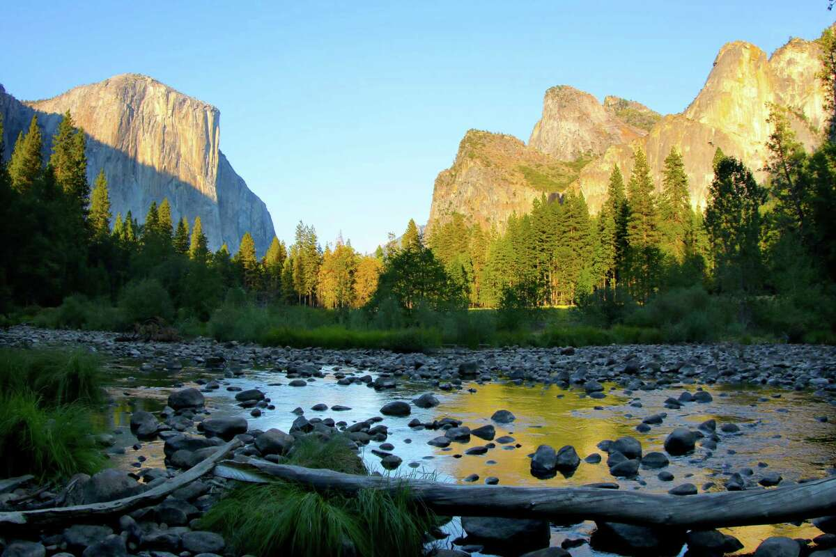 """Sunrise in Yosemite Valley looking onto El Capitan and Cathedral Rocks. From MacGillivray Freeman""""s """"National Parks Adveture 3D,"""" now showing at the Houston Museum of Natural Science."""