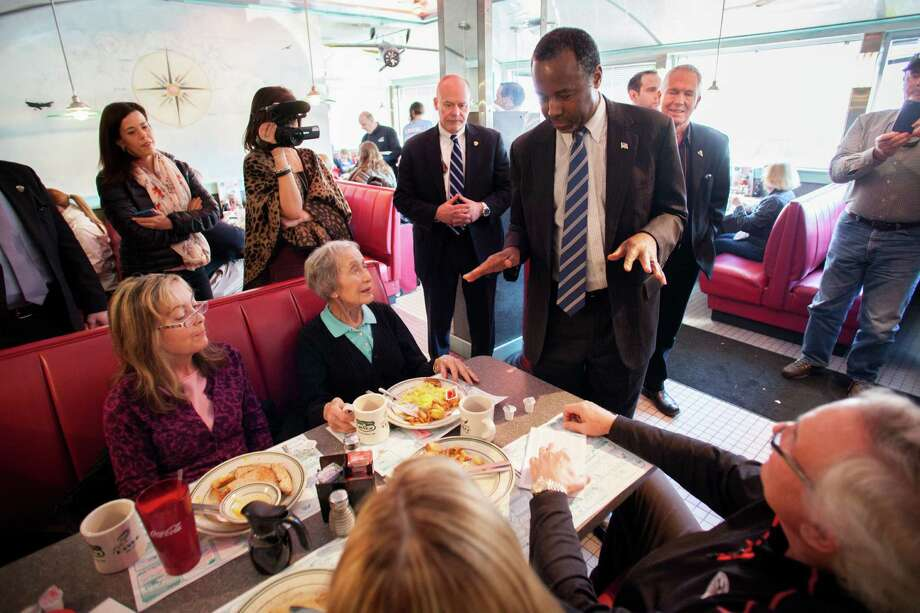 Republican presidential candidate Ben Carson speaks to patrons at The Airport Diner earlier this week in Manchester, New Hampshire. A reader says Carson was the victim of dirty tricks by another GOP hopeful, Sen. Ted Cruz. Photo: Matthew Cavanaugh /Getty Images / 2016 Getty Images
