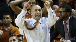 Texas head coach Shaka Smart shouts at his team during the second half against Oklahoma in Norman on Feb. 8, 2016.