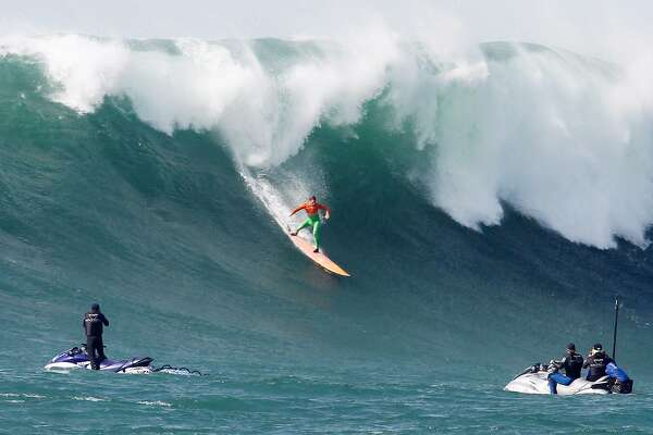 Nic Lamb rides a wave in the semi-finals of the Titans of Mavericks surf contest in Half Moon Bay, CA on Friday, February 12, 2016.