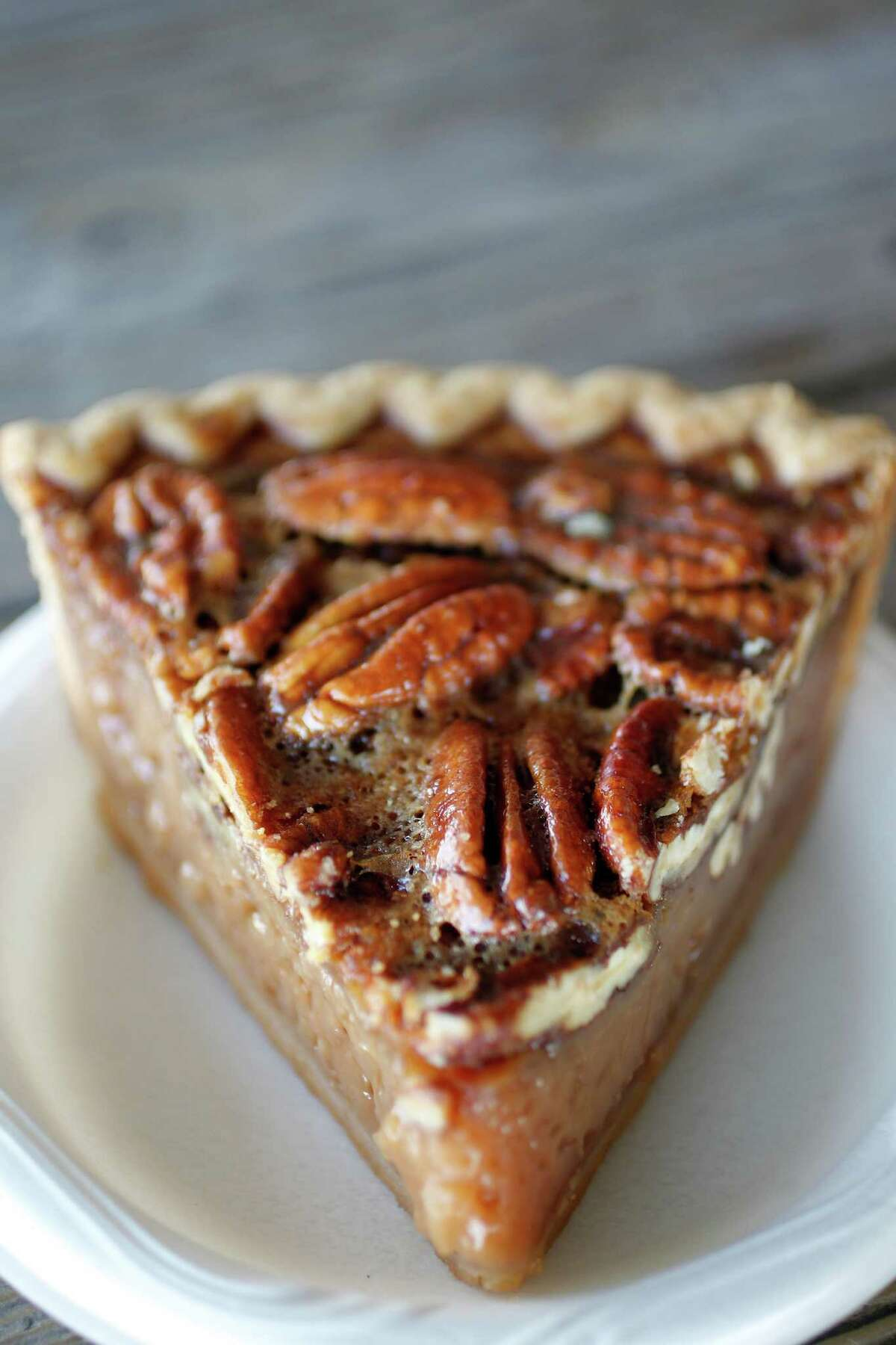 Goode Co. (Various locations) Head to a Goode concept, including Armadillo Palace, Goode Co. Texas Bar-B-Q, Goode Co. Seafood and Goode Co. Taqueria, for your fix of Brazos bottom pecan pie. The nine-inch pie, which comes in a wooden box, is made with Texas pecans harvested from the banks of the Brazos River. Pictured: Brazos bottom pecan pie.