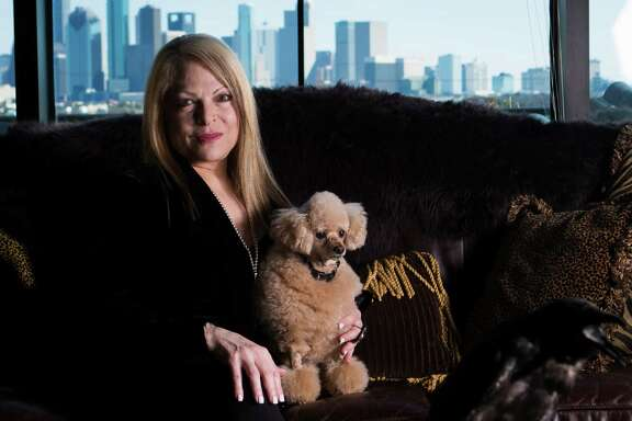 Paula Fridkin, a native Houstonian, jewelry designer and  entrepreneur holds her toy poodle called  Aubrey at her home.