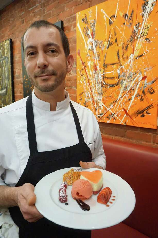 Bistro V Executive Chef Cedric Lamouille holds the desert special he created for Valentine's Day weekend at the newly rebranded restaurant, formerly known as Bistro Versailles. Photo: Contributed / Contributed Photo / Greenwich Time Contributed