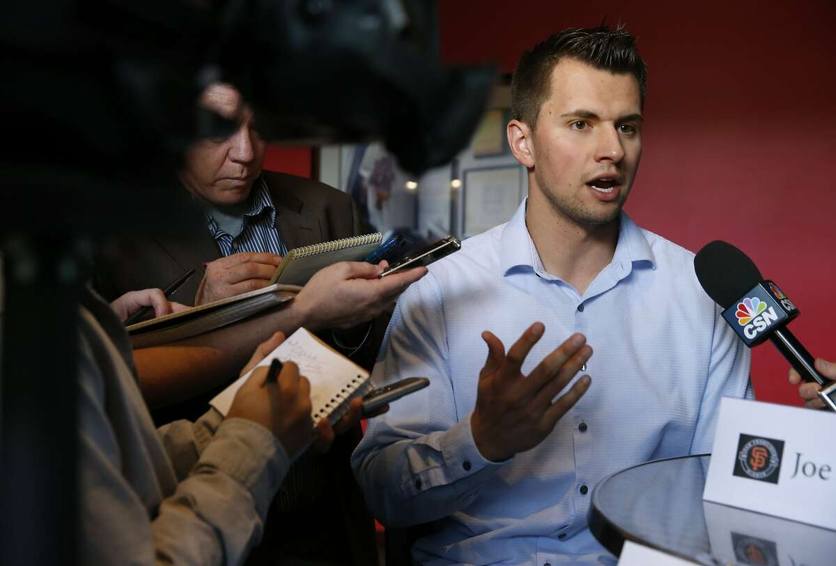 Joe Panik is interviewed by sports reporters at AT&T Park in San Francisco on Feb. 12. in advance of the Giants' annual FanFest event.